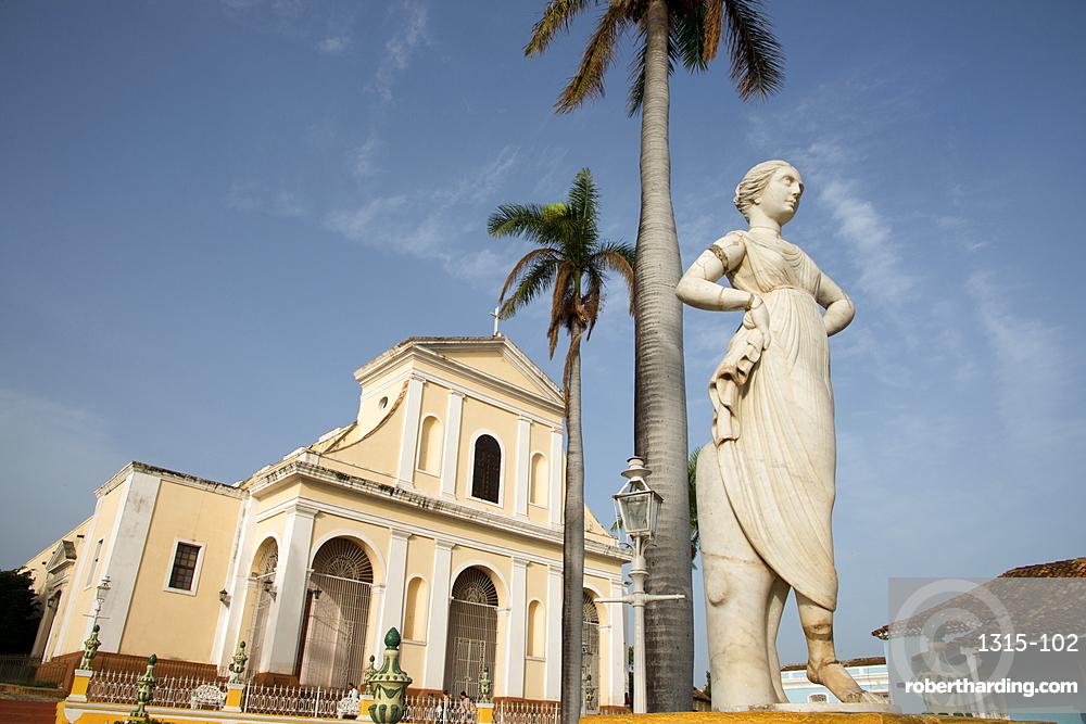 Statue in Plaza Mayor, Church of the Holy Trinity (Iglesia de la Santísima Trinidad) in the background.