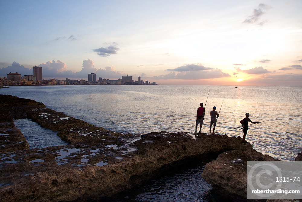 Fishing along the Malecon at sunset in Havana, Cuba