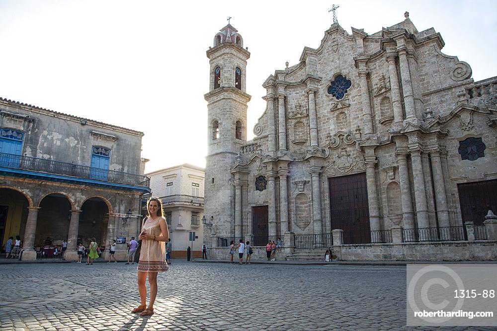 Tourist in Cathedral Square (Plaza de la Catedral) in Old Havana, Havana, Cuba. Model release 239