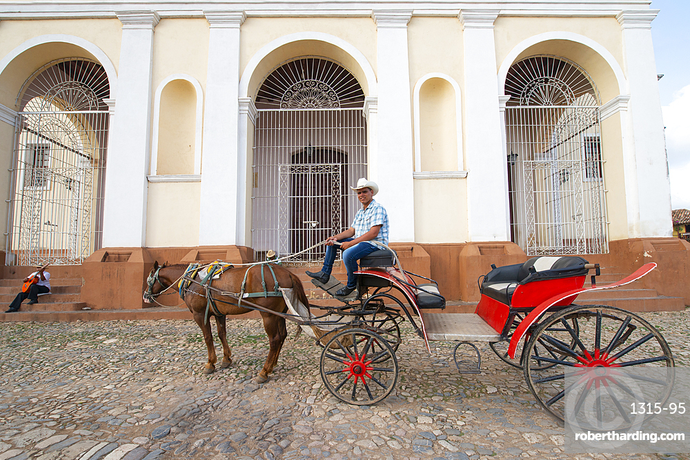 Plaza Mayor, UNESCO World Heritage Site, featuring the Church of the Holy Trinity in Trinidad, Cuba.