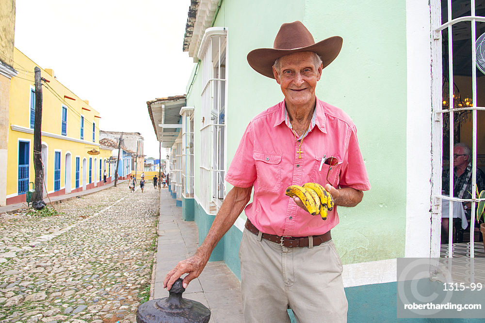 Man selling bananas on a street corner in Trinidad, Cuba, West Indies, Caribbean, Central America