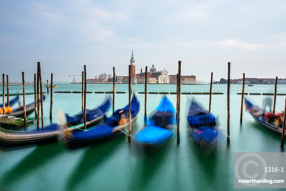 Gondolas moored in Piazza San Marco with San Giorgio Maggiore church in the background