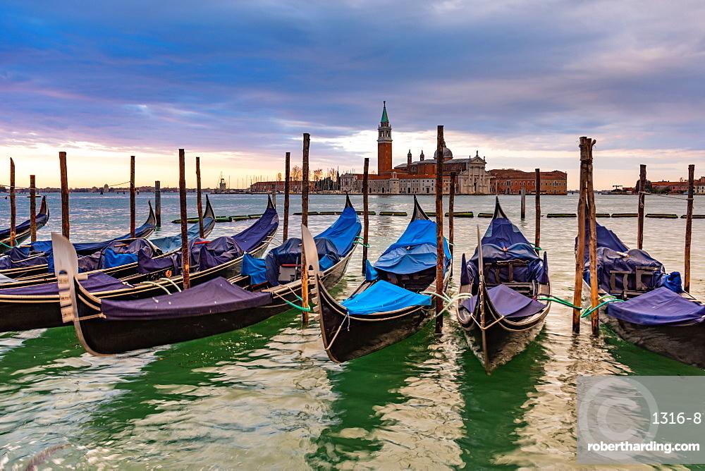 Gondolas moored in Piazza San Marco with San Giorgio Maggiore church in the background
