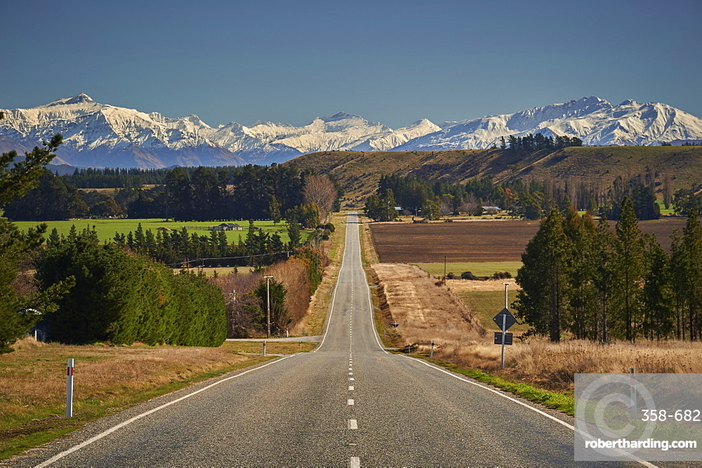 Open road on State Highway 6 near Cromwell, Central Otago with views to the ski fields at Wanaka.