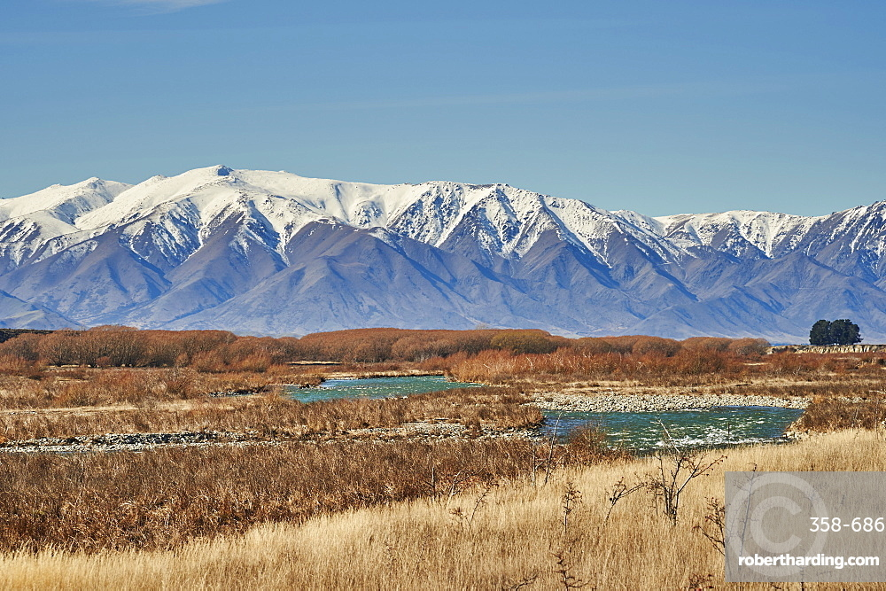 View to Southern Alps over a mountain stream near Twizel, Central Otago, South Island, New Zealand, Pacific