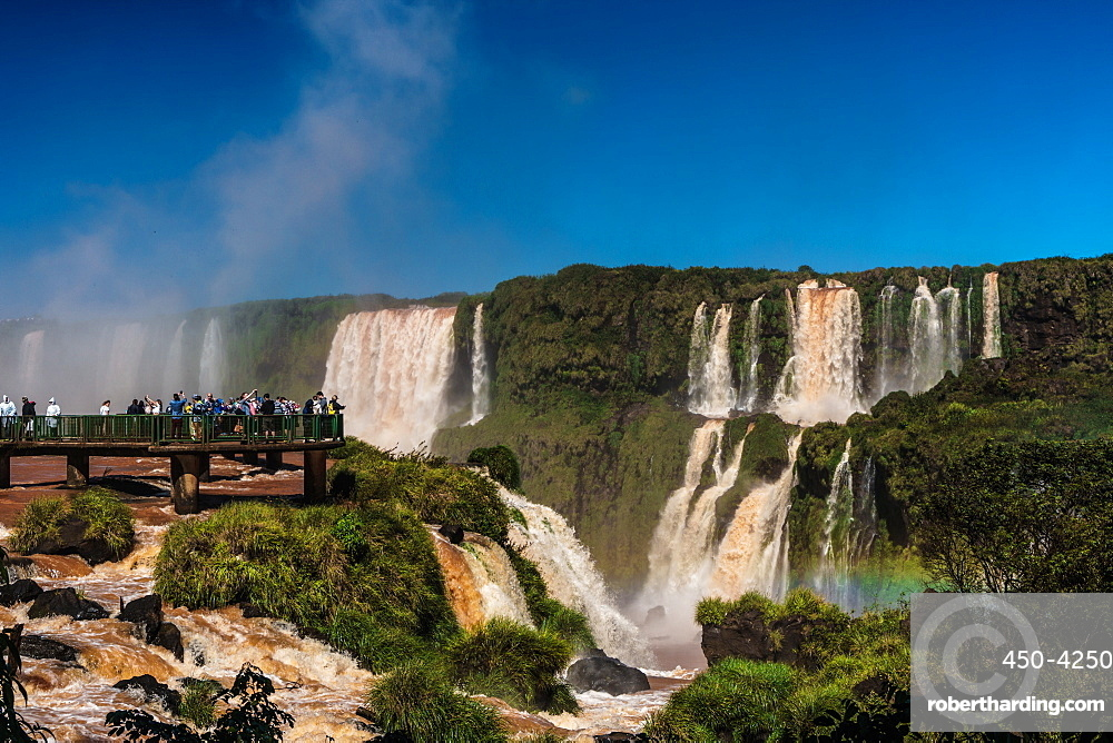 Visitors, drenched in spray, Garganta del Diablo (Devil's Throat), Iguazu Falls, UNESCO World Heritage Site, Iguazu, Brazil, South America