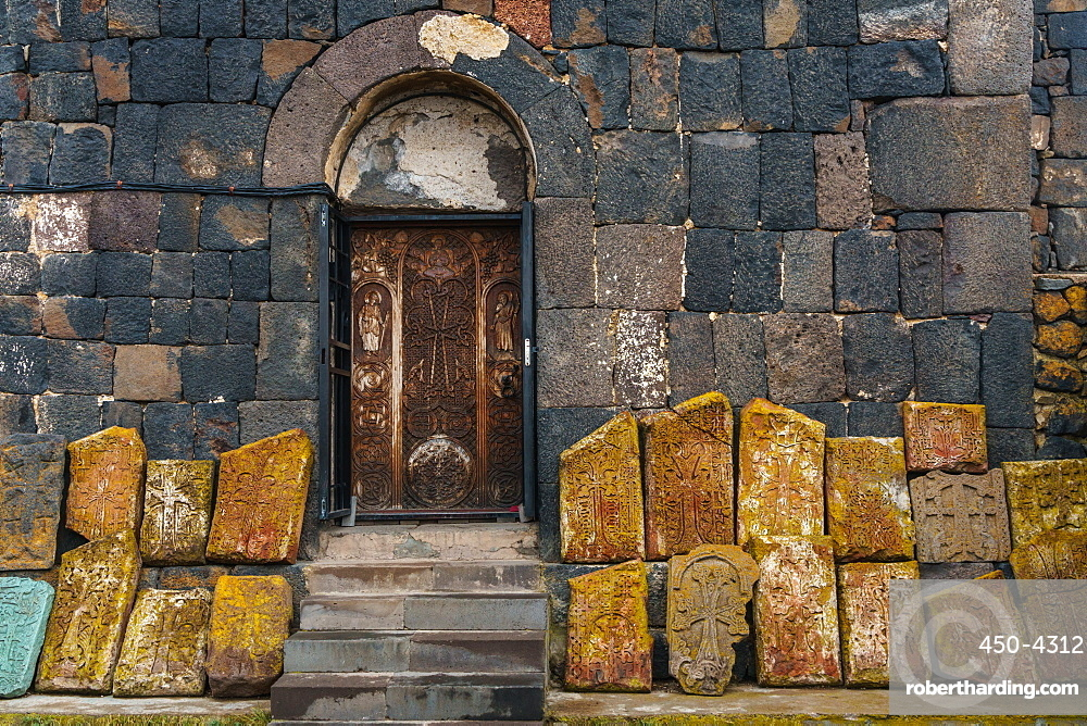 Facade of 9th Century church, Sevanank Monastery, with propped up khachkars (carved memorial stones), Lake Sevan, Sevan, Armenia