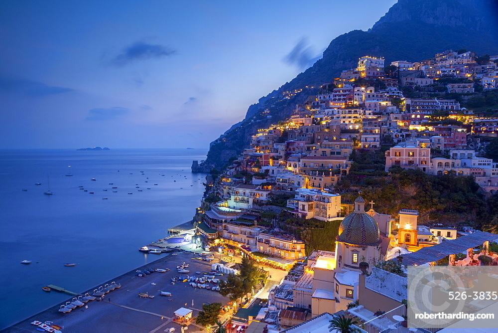 Positano and beach at dusk, Amalfi Coast (Costiera Amalfitana), UNESCO World Heritage Site, Campania, Italy, Mediterranean, Europe