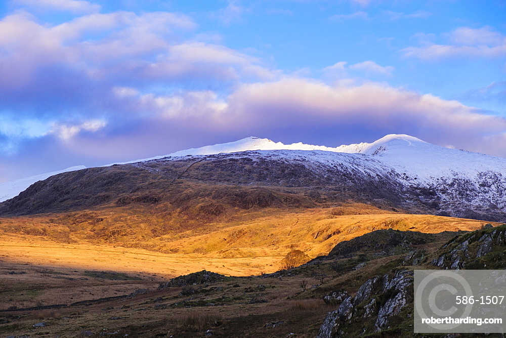 Late afternoon view to snow capped Mount Snowdon in winter in Snowdonia National Park, Rhyd Ddu, Gwynedd, Wales, United Kingdom, Europe