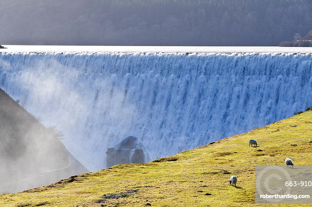 Elan Valley, Powys, Wales, UK. Water cascades over the Caban-coch dam, at Elan Valley village near Rhayader in Powys, Wales, UK.