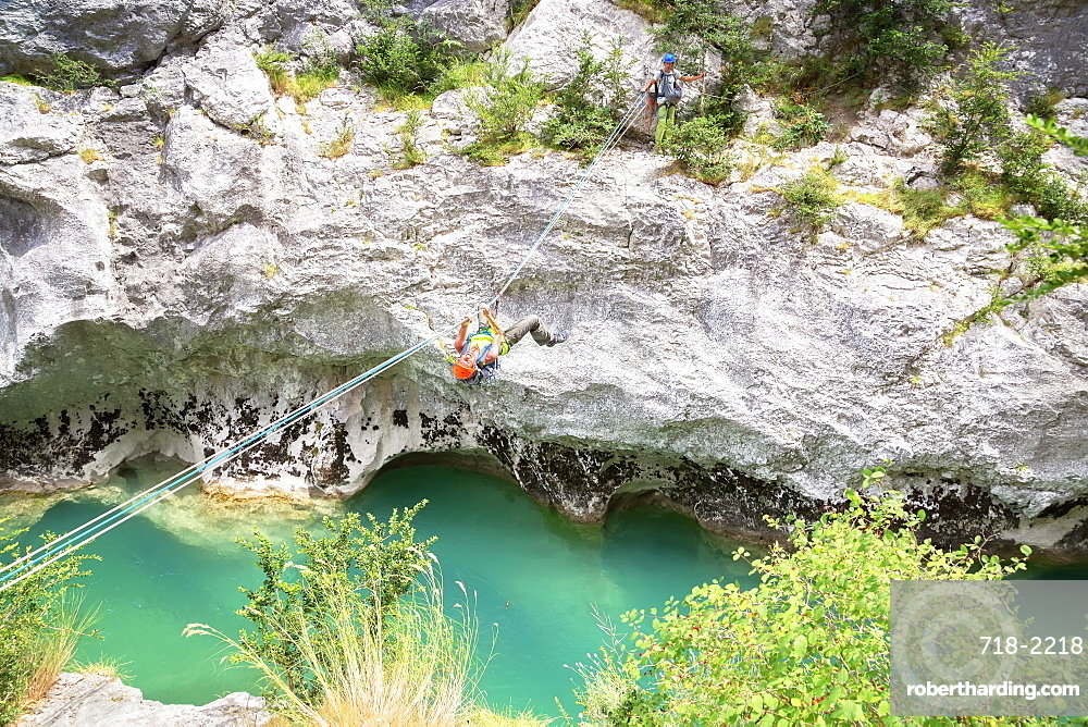 Man crossing the Verdon River on a rope, Provence-Alpes-Cote d'Azur, Provence, France, Europe