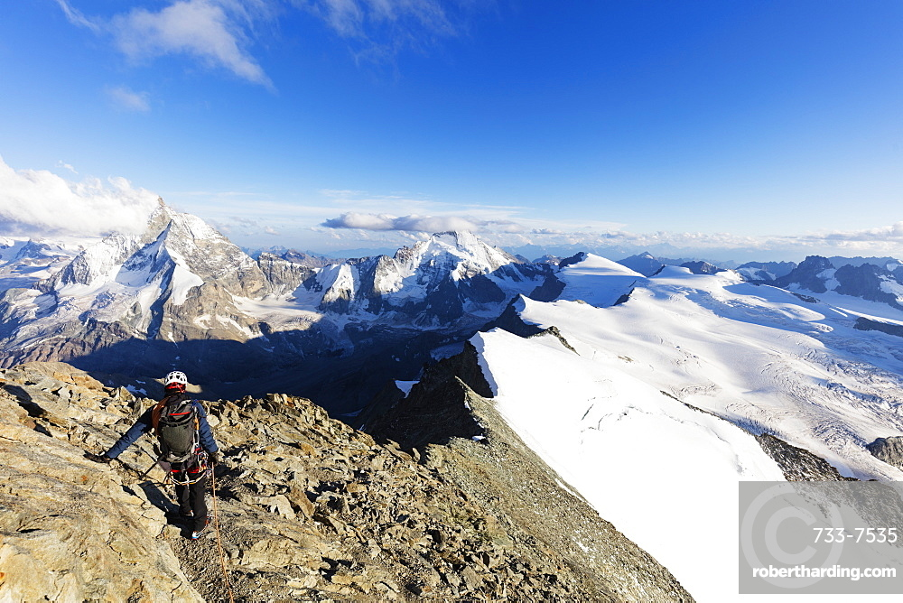 Climber on south ridge of Dent Blanche, 4357m, with view to the Matterhorn, Valais, Swiss Alps, Switzerland, Europe