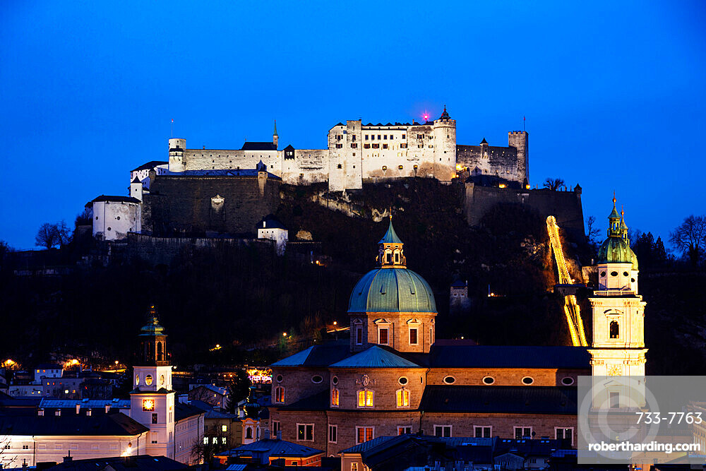 View of the old town, UNESCO World Heritage Site, and Hohensalzburg Castle at dusk, Salzburg, Austria, Europe
