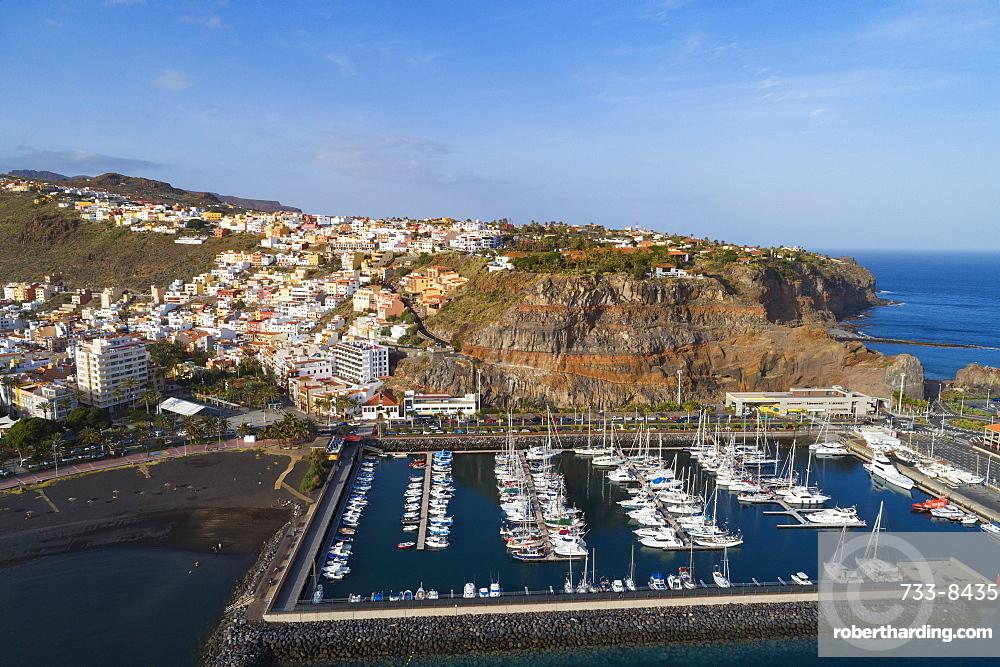 Europe, Spain, Canary Islands, La Gomera, Unesco Biosphere site, San Sebastian de la Gomera town and marina aerial view (drone)