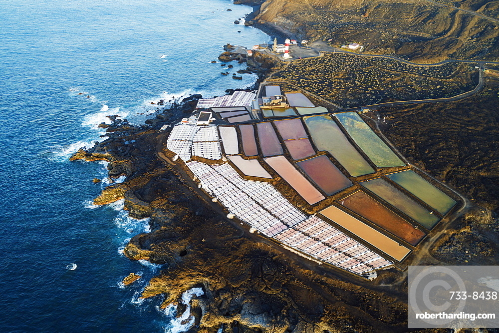Europe, Spain, Canary Islands, La Palma, Unesco Biosphere site, aerial view of the salt pans and lighthouse at Faro de Fuencaliente