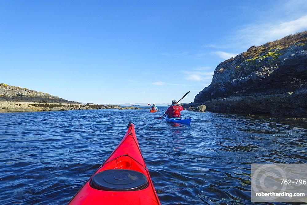 Sea kayaking around the Inner Hebrides, Scotland, United Kingdom, Europe