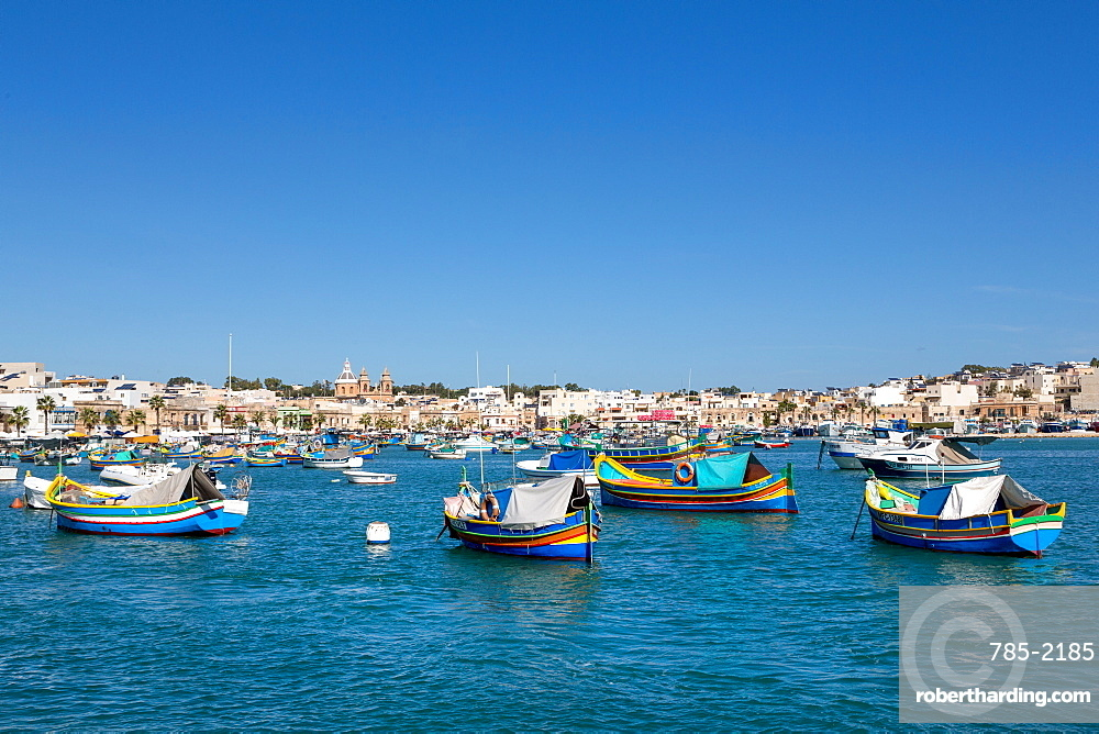 Traditional, brightly painted, fishing boats in the harbour at Marsaxlokk