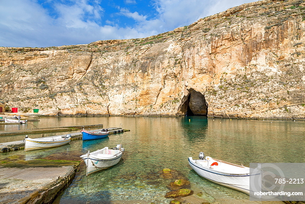 Traditional boats in the harbour at Dwejra Inland Sea in Gozo, Malta, Mediterranean, Europe