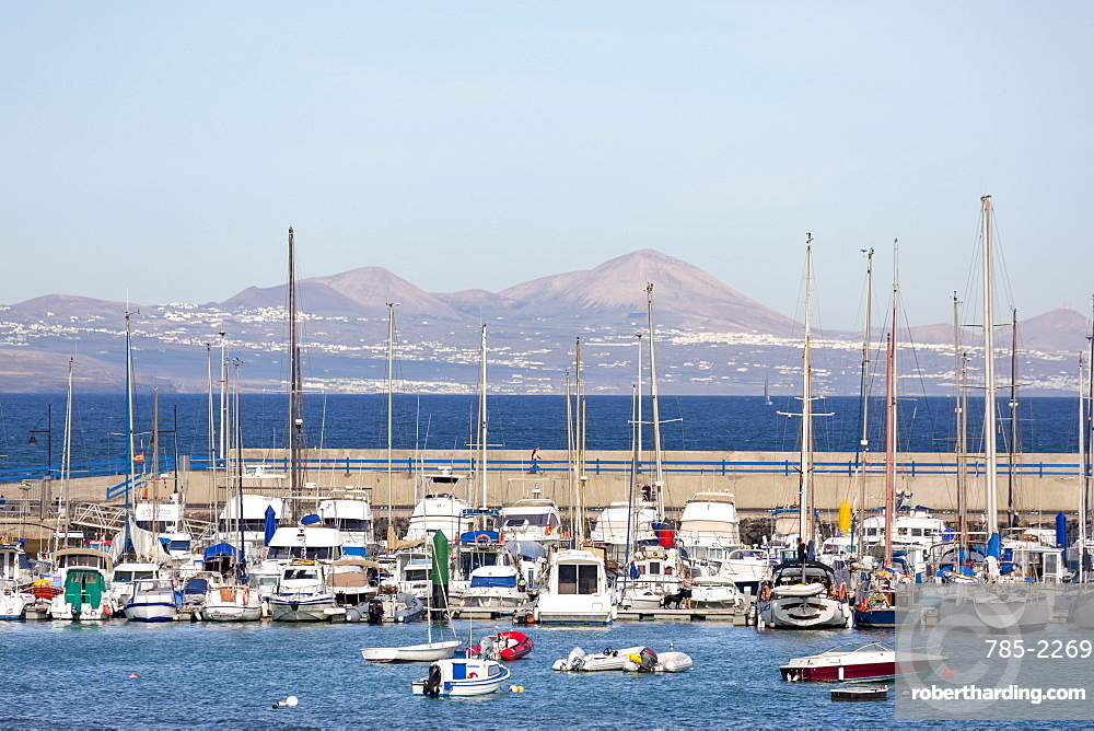 The harbour at Corralejo on the island of Fuerteventura with Lanzarote in the distance, Fuerteventura, Canary Islands, Spain, Atlantic, Europe