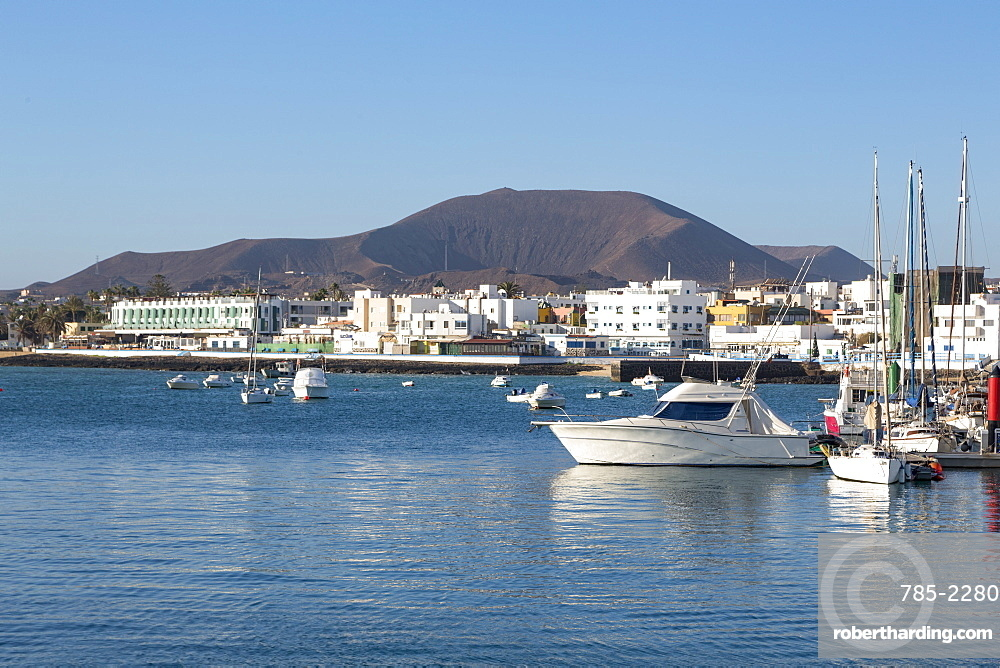 The harbour at Corralejo on the island of Fuerteventura with a volcano in the distance, Fuerteventura, Canary Islands, Spain, Atlantic, Europe