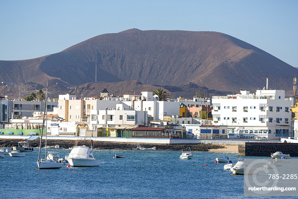 The waterfront of old town Corralejo on the island of Fuerteventura with a volcano in the distance, Fuerteventura, Canary Islands, Spain, Atlantic, Europe