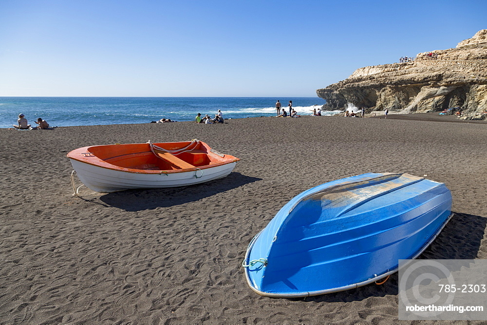 Small fishing boats on Playa Ajuy on the volcanic Canaries island of Fuerteventura
