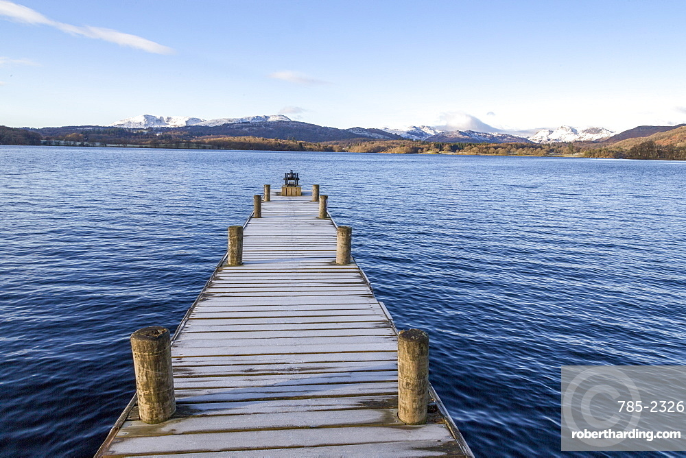 Frost covered jetty at the north end of Windermere near Ambleside, with rugged snow covered mountains including Helvellyn, Lake District National Park, UNESCO World Heritage Site, Cumbria, England, United Kingdom, Europe