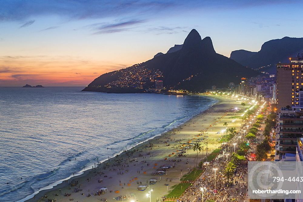 Sunset over Ipanema Beach and Dois Irmaos (Two Brothers) mountain, Rio de Janeiro, Brazil, South America