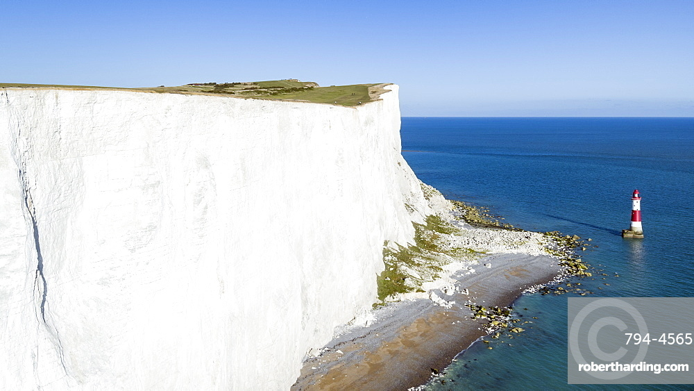 White chalk cliffs of Beachy Head and lighthouse, South Downs National Park, near Eastbourne, East Sussex, England, United Kingdom, Europe (Drone)