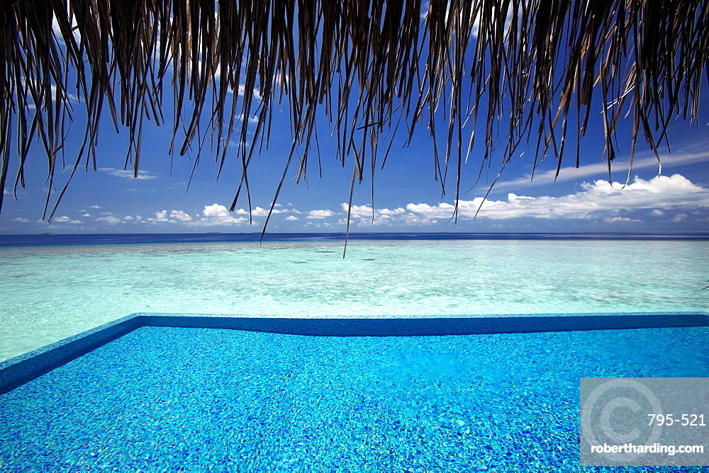 Infinity pool and lagoon, Maldives, Indian Ocean, Asia