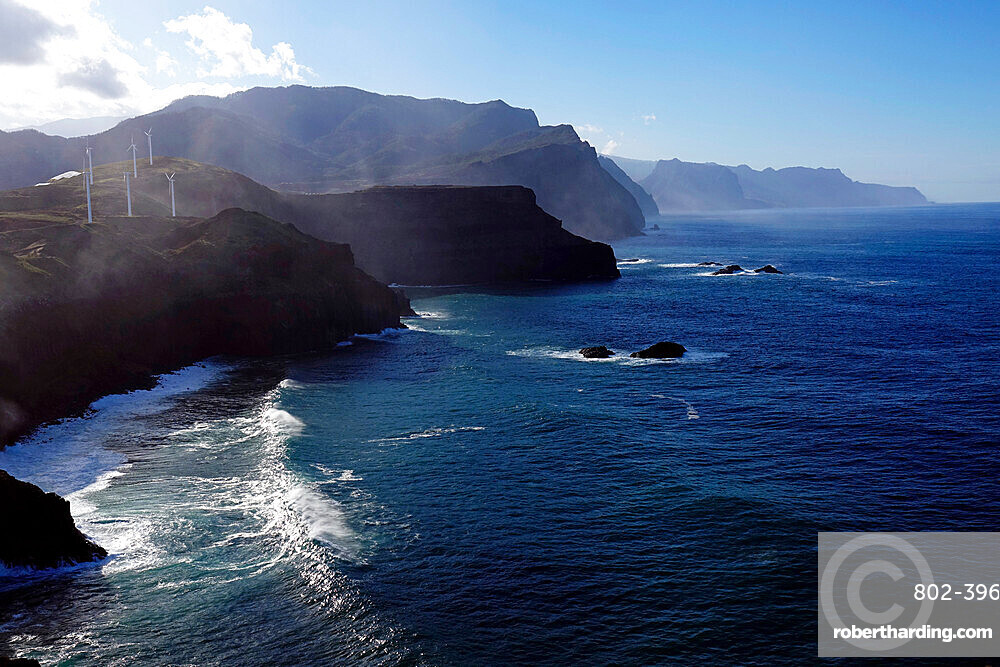 The dramatic sea cliffs of the northwest coast rise beyond the Sao Lourenco peninsula, eastern Madeira, Portugal