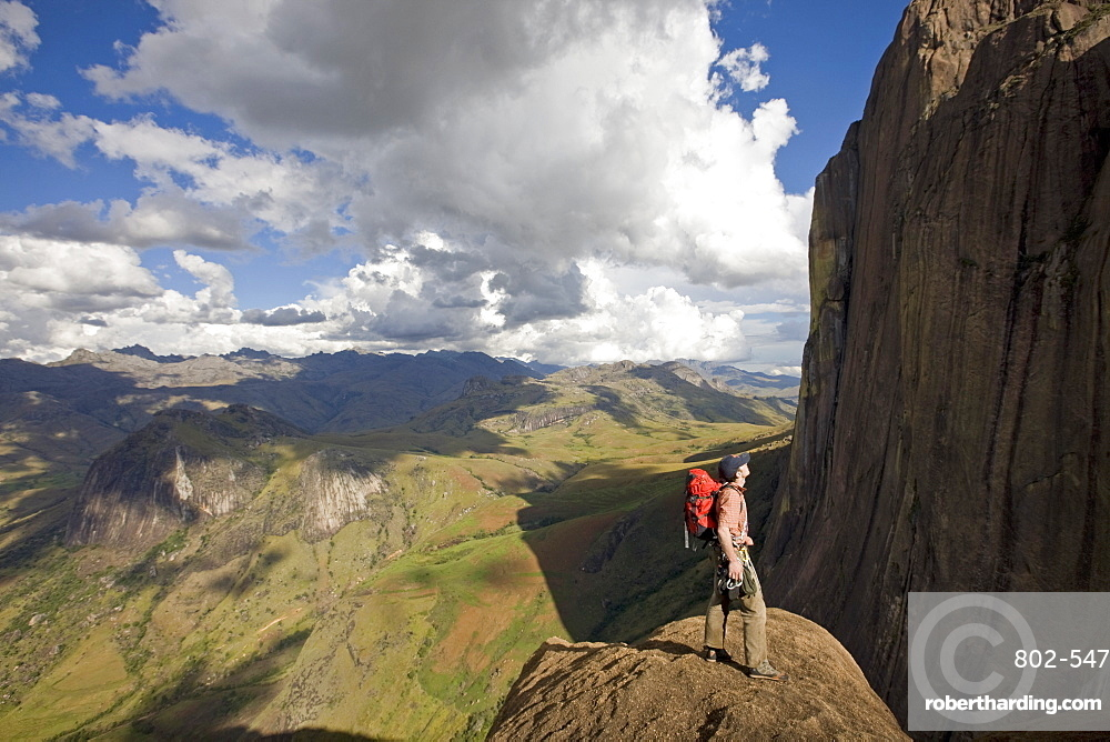 Climber looks across the Tsaranoro Massif, southern Madagascar, Africa