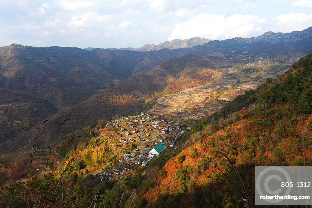 View across Naga hills over small Naga village, terraced ricefields and farmland, Nagaland, India, Asia