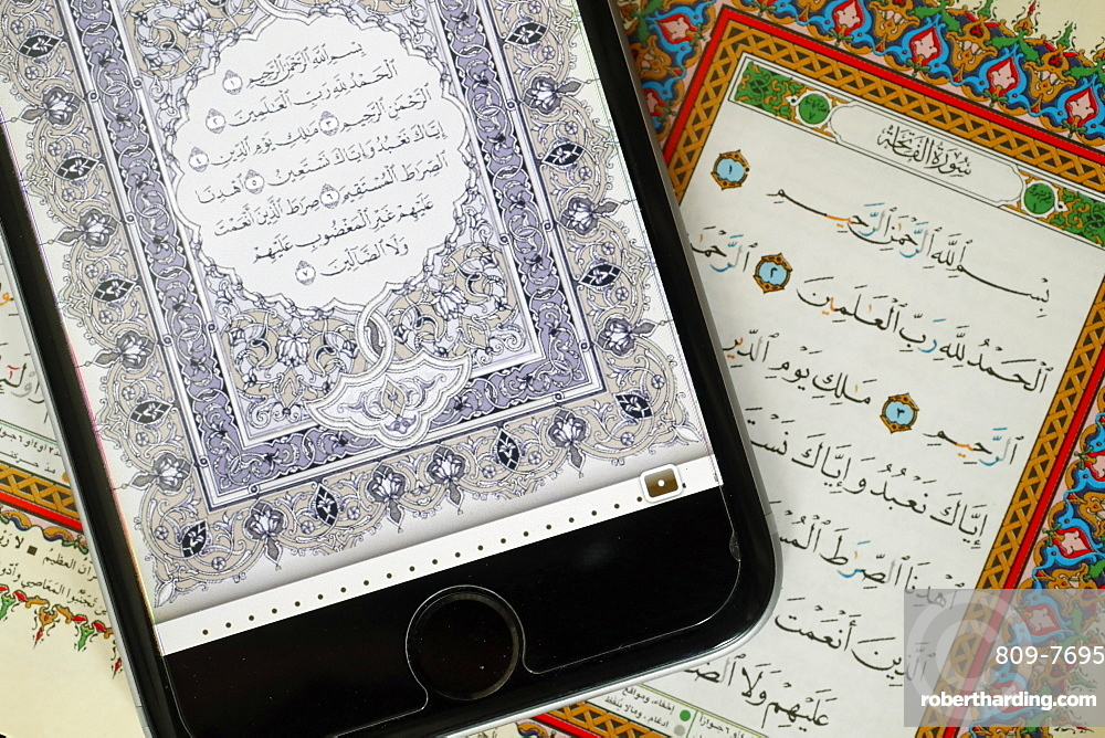 Digital Quran on a smartphone and Holy Quran book, Surat al-Fatiah, the first chapter, Vietnam, Indochina, Southeast Asia, Asia