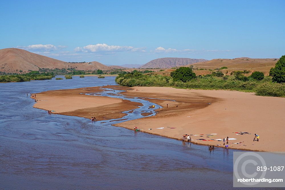 People washing clothes in the Manambolo river, Ambatolahy, Miandrivazodistrict, Menabe Region, Madagascar