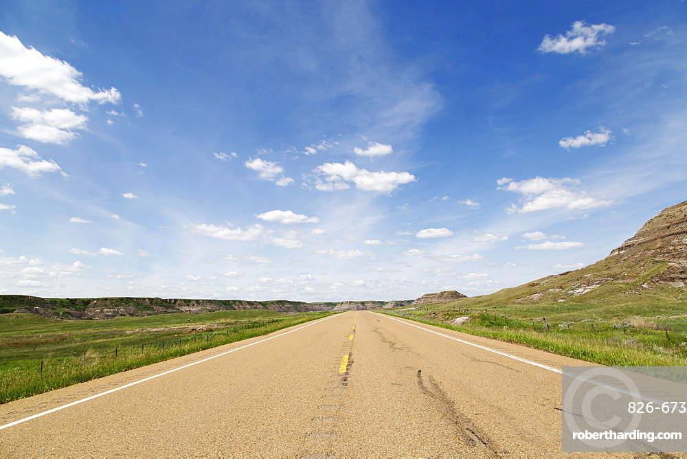 Blue sky over a highway through the Badlands of Alberta, near Drumheller, Alberta, Canada, North America