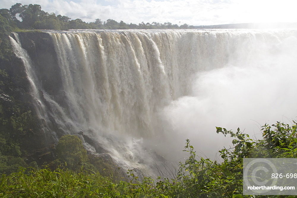 The River Zambezi crashes over the Victoria Falls waterfall (Mosi-oa-Tunya) on the border of Zimbabwe and Zambia