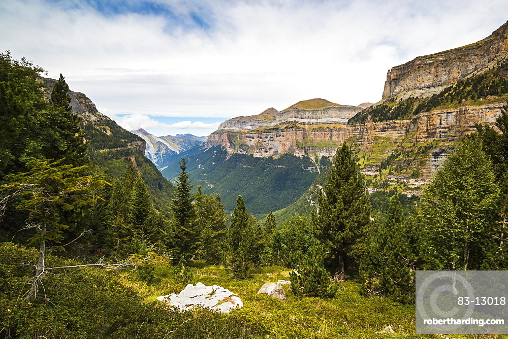 View west along the Ordesa Valley to distant Mondarruego and Otal peaks, Ordesa National Park, Pyrenees, Aragon, Spain, Europe