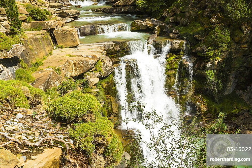 Steps of limestone strata make a waterfall on the Rio Arazas, upper Ordesa Valley, Ordesa National Park, Pyrenees, Aragon, Spain, Europe