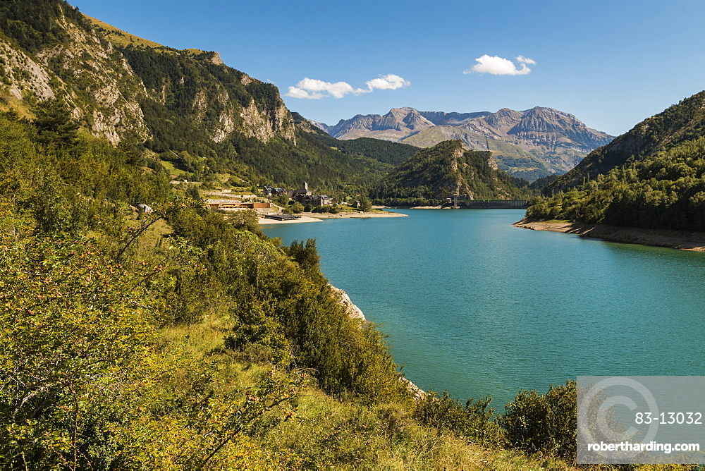 Lanuza village and resevoir, with Sierra Tendenera range beyond, Tena Valley, Sallent de Gallego, Pyrenees, Huesca Province, Spain, Europe