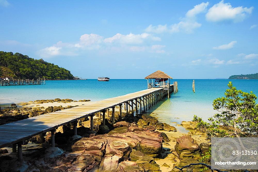 Pier at the beautiful white sand beach on this holiday island; Saracen Bay, Koh Rong Sanloem Island, Sihanoukville, Cambodia
