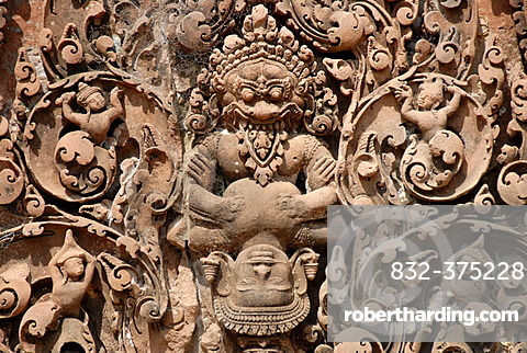 Tantric stone relief demon and apsara temple Banteay Srei Angkor Siem Reap Cambodia