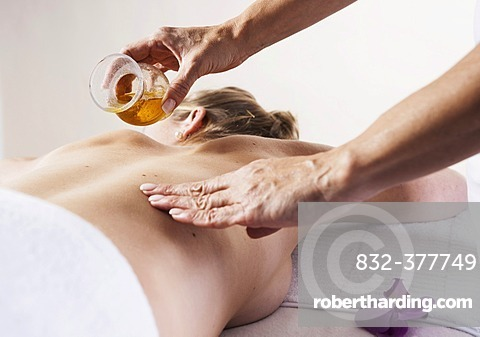 Young woman receiving an oil massage