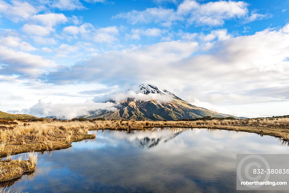 Reflection in Pouakai Tarn, stratovolcano Mount Taranaki or Mount Egmont, Egmont National Park, Taranaki, New Zealand, Oceania