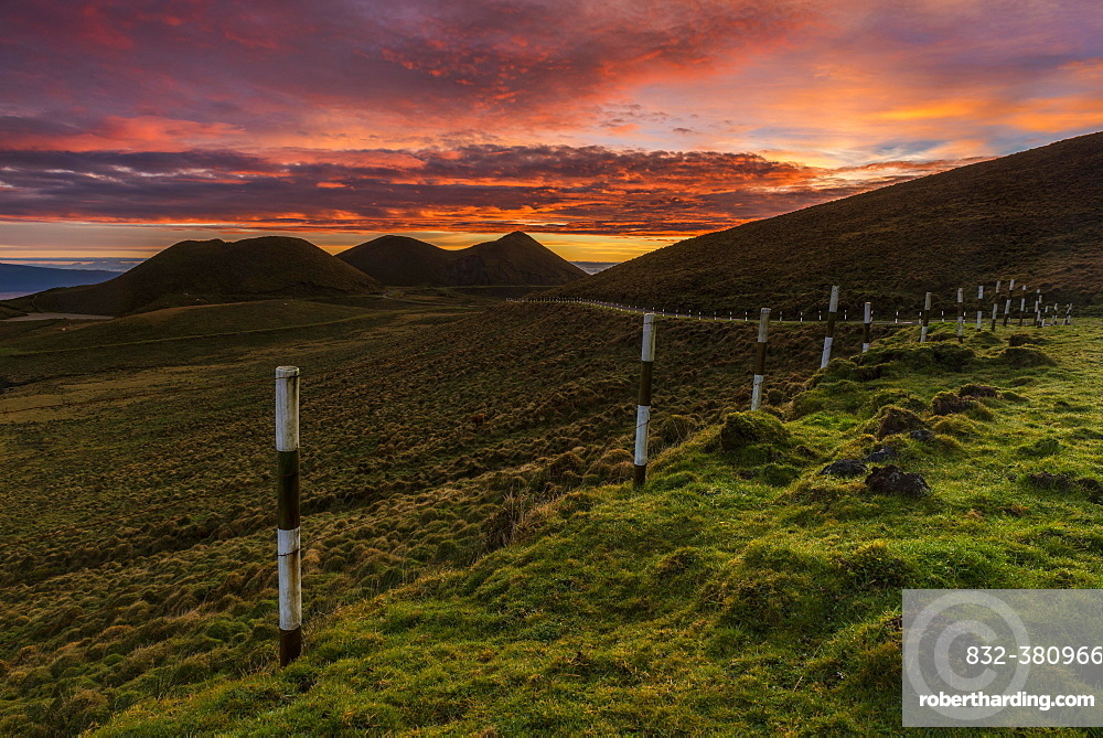 Volcano cone and street at sunrise, dramatic lighting scene, island of Pico, Azores, Portugal, Europe