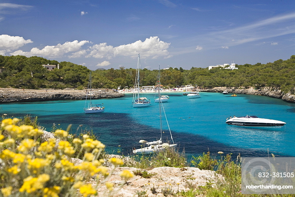 Sailing yachts in the Cala Mondragó bay, beach of Caló d'en Garrot, natural park of Mondragó, Mallorca, Majorca, Balearic Islands, Mediterranean Sea, Spain, Europe