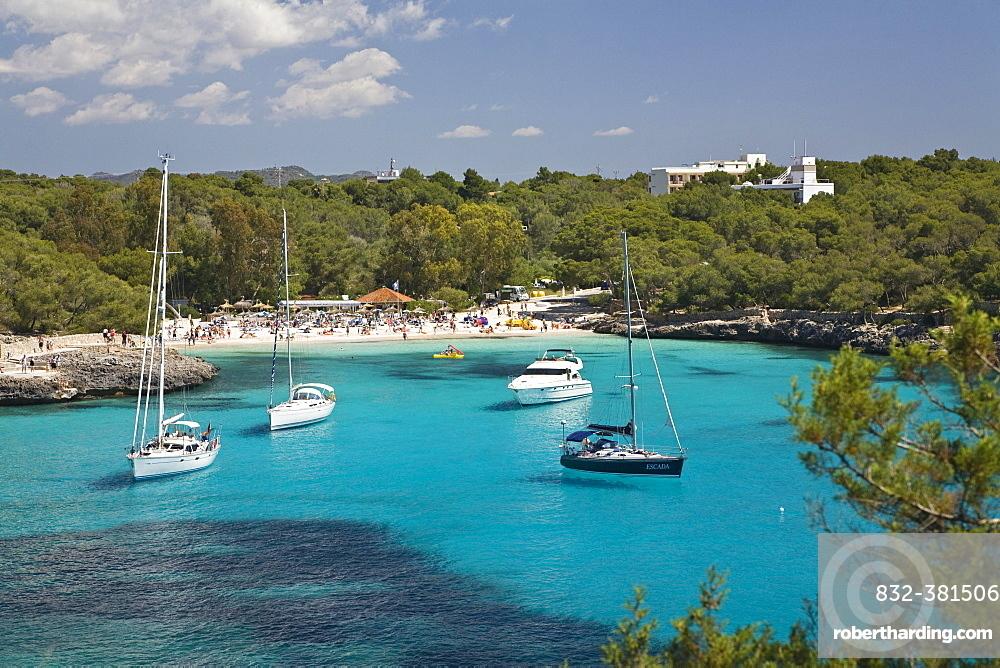 Bay Cala Mondragó with sailing yachts, beach Caló d'en Garrot, natural park of Mondragó, Mallorca, Majorca, Balearic Islands, Mediterranean Sea, Spain, Europe