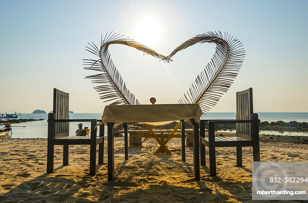Laid table with a heart of palm fronds, sunset, Koh Samui, Gulf of Thailand, Thailand, Asia