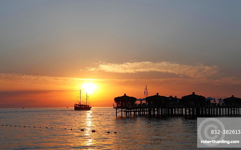 Excursion boat, sailing ship at the pier at sunset, Manavgat, Antalya, Turkey, Asia