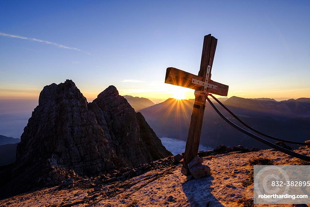 Summit cross of the third Watzmannkind in front of first and second Watzmannkind, sunrise, Watzmannkar, Watzmann, Berchtesgaden National Park, Berchtesgaden Alps, Schonau am Konigsee, Bavaria, Germany, Europe